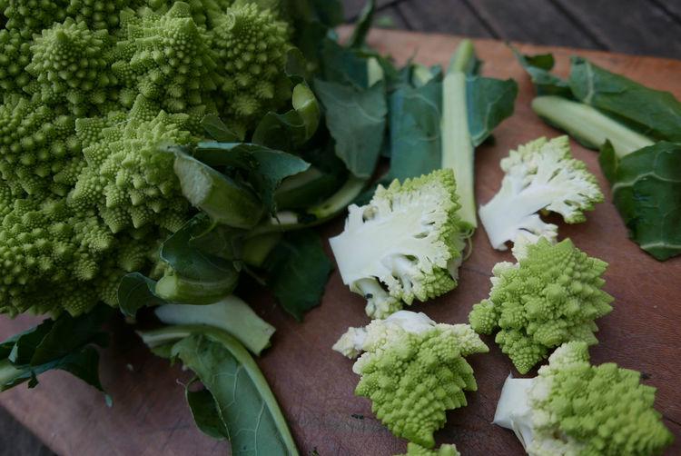 Close-up of chopped romanesco cauliflower on cutting board