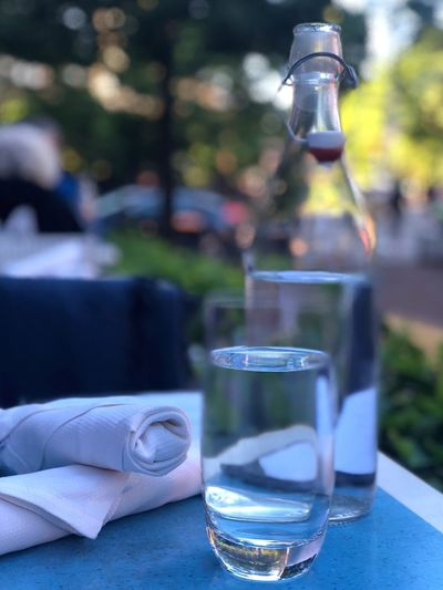Summer dinning, Aka outdoor time! 🌿 Dinner Dining Water Outdoors Table Bottle Drink Glass - Material Container Focus On Foreground Refreshment No People Still Life Transparent Business Glass Close-up Restaurant Freshness Drinking Glass Food And Drink Selective Focus The Still Life Photographer - 2018 EyeEm Awards
