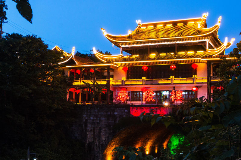 Illuminated temple building against sky at night