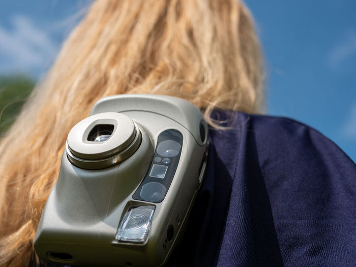 Rear view of woman using mobile phone
