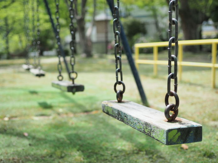 Scenery of a little old playground equipment (少し古い遊具の風景) Ad Copy Space Daytime Green Japan Black Color Brown Chain Close-up Gray Landscape Margin No People No Person Nobody Outdoor Play Equipment Outdoors Park Play Play Equipment Playground Swing Text Space White ブランコ