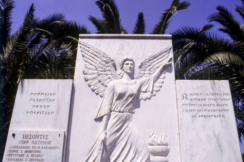 White Marble Second World War Memorial, Benitses, Corfu, Greece Angel Benitses Corfu, Greece Day Ionian Islands Kerkyra Low Angle View Marble Memorial Monument No People Outdoors Relief Sculpture Statue Travel Photography Tribute War Memorial World War Two