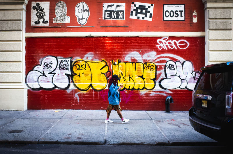 Rear view of graffiti on wall