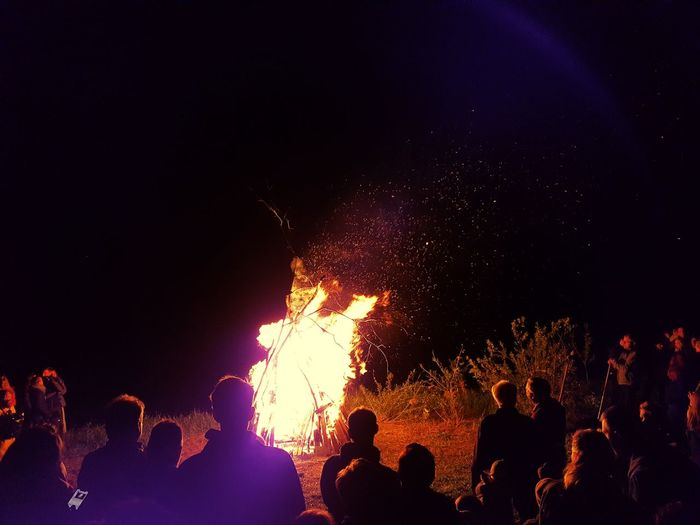 Group of people by campfire at night