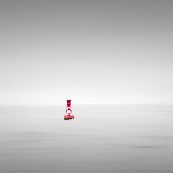 Lighthouse On Sea Against Clear Sky