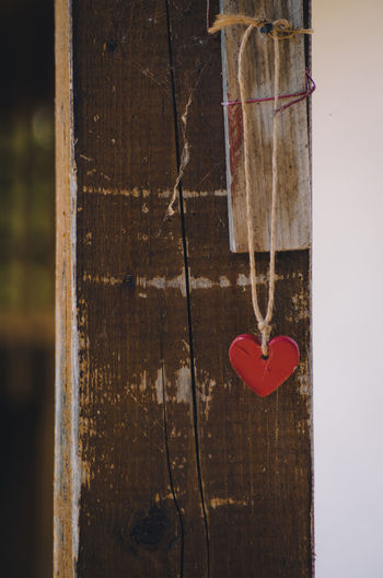 Close-up of red heart shape hanging on door
