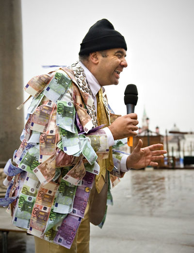 Street Performer With Currency Jacket Holding Microphone