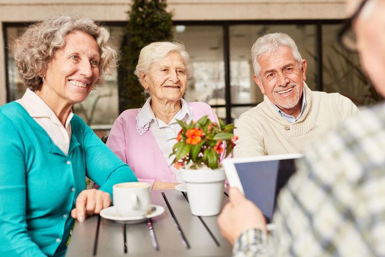 Senior people having discussion while sitting at nursing home