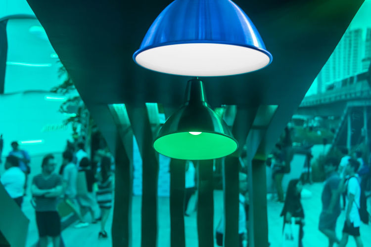 Beverage booth decoration and design with modern lamp. Green plastic sheet to be mirror crowd. Abstract Art Blue Ceiling Creative Crowd Dark Decoration Decorative Electric Lamp Electric Light Electricity  Green Hanging Home Interior Illuminated Indoors  Inspiration Interior Lamp Light Lighting Equipment Lit Reflect Reflection
