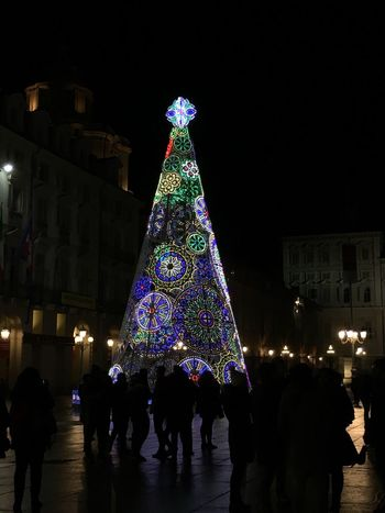 Christmas Tree Christmas Illuminated Night Celebration Christmas Lights Christmas Decoration Architecture Tree Topper Built Structure Large Group Of People Building Exterior Real People Vacations Tree Holiday - Event Travel Destinations Winter Men City