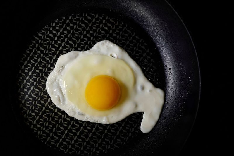 Yummy Healthy Food Healthy Lifestyle Healthy Eating Cooking Time Cooking Pan Cooking Oil Breakfast Cooking At Home Cooking Egg Egg Yolk Freshness Healthy Eating Food And Drink Food Wellbeing Fried Egg Egg White Ready-to-eat Fried Still Life Close-up Frying Pan Meal High Angle View Yellow Preparation