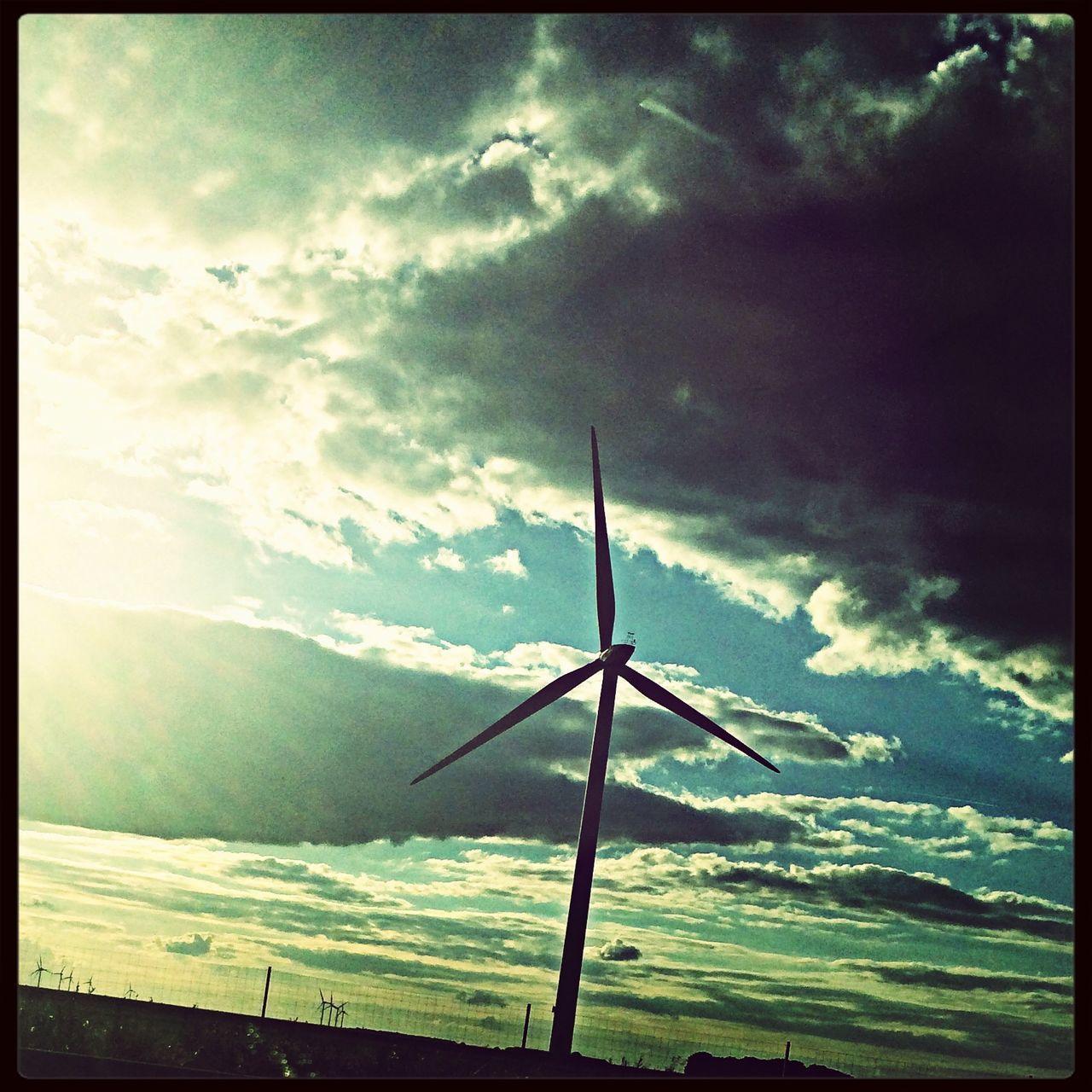 Windmill Against Cloudy Sky