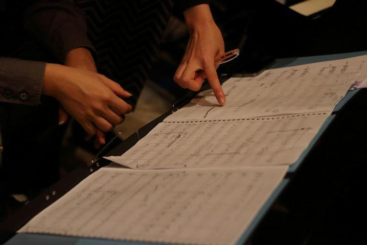 Cropped Hands Of Women Composing Music Notes