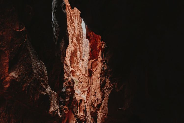 Low angle view of rock formation at night