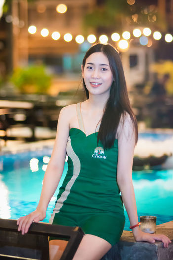 Asian Woman Adult Asian Girl Asian Teen Beautiful Woman Beauty Focus On Foreground Front View Hair Hairstyle Happiness Lifestyles Long Hair Looking At Camera One Person Outdoors Pool Portrait Smiling Swimming Pool Young Adult Young Women