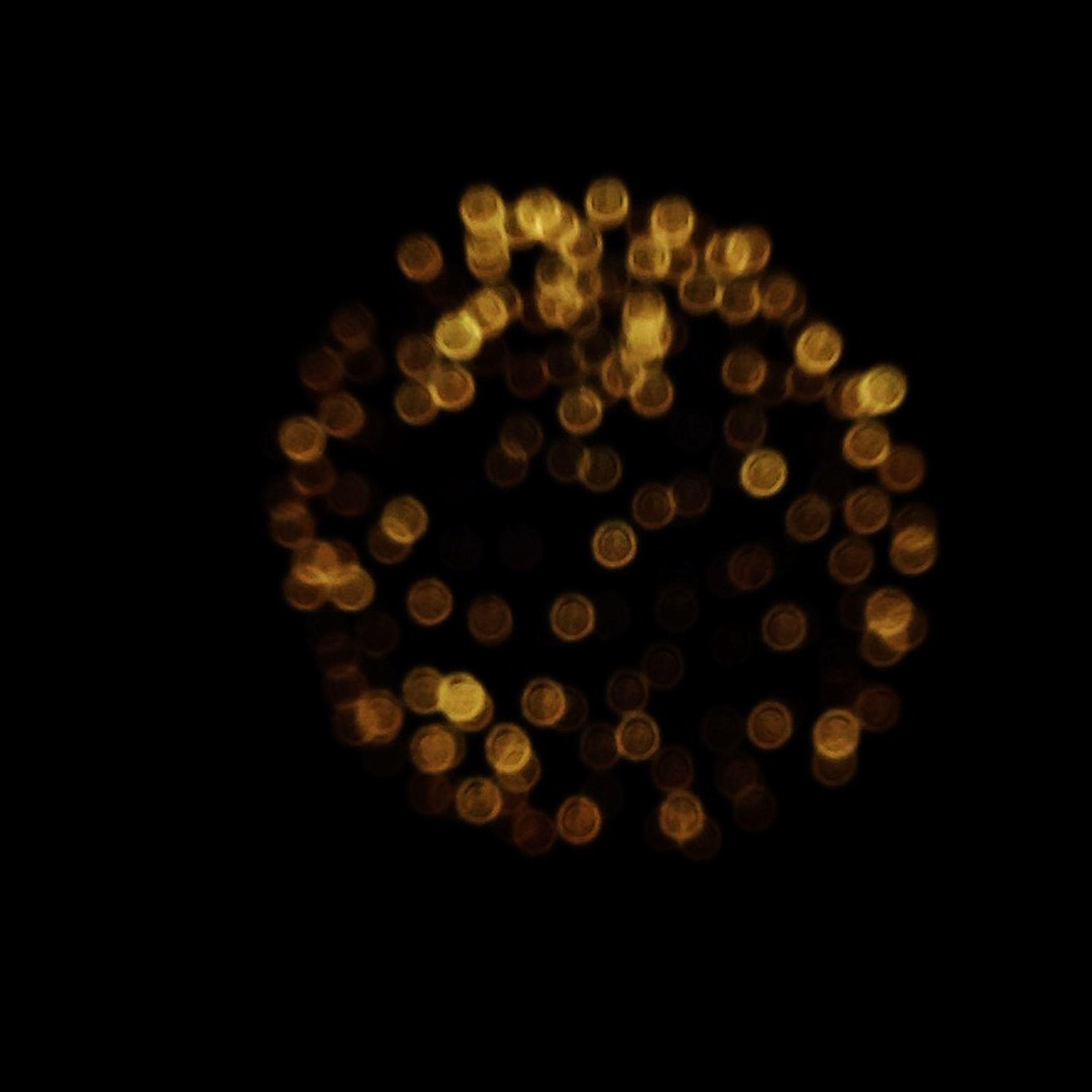 black background, night, studio shot, illuminated, dark, indoors, copy space, close-up, glowing, circle, darkroom, still life, lighting equipment, burning, no people, large group of objects, light - natural phenomenon, lit, flame, heat - temperature