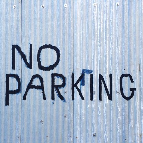 No parking. Bristol, England. Photo by Tom Bland. Text Outdoors IPhone IPhoneography City Urban Message No Parking No Parking Sign Scribble Scribbles Scrawl Metal Corrugated Iron Street England Bristol Bristol, England Street Parking