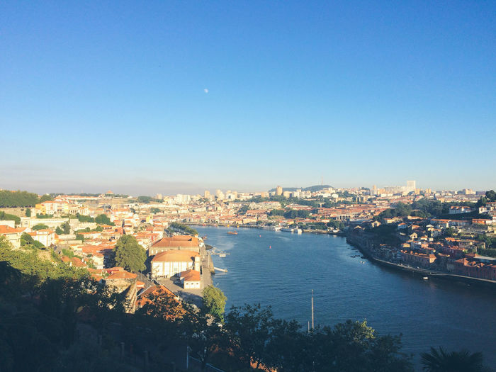 Architecture Blue Building Exterior Built Structure Church City City Life Cityscape Community Day Douro River Portugal Garden Human Settlement Nature No People Outdoors Residential Building Residential District Residential Structure River Sky Town TOWNSCAPE Trees Water