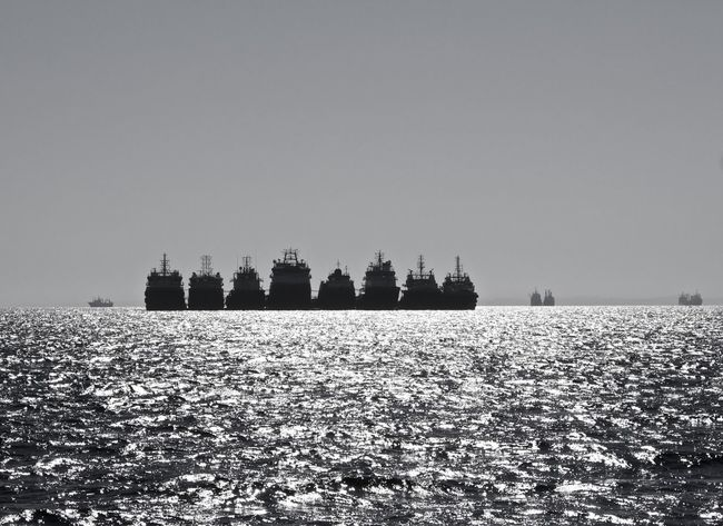 Beauty In Nature Black And White Black And White Collection  Blackandwhite Photography Boats Clear Sky Drilling Rig EyeEm Nature Lover Horizon Over Water Idyllic Scenery Monochrome Namibia Nature Nautical Nautical Vessel No People Outdoors Sea Sea And Sky Seafront Ships Silhouette Sky Water Waterfront