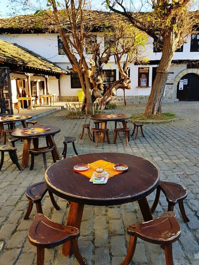 Street cafe Street Street Photography Bulgaria Warm Outdoors Street Cafe Empty Street Empty Chairs Morning Tryavna Sky Travel Wood - Material Tree Place Setting Plate Furniture Chair Table Restaurant Outdoor Cafe Architecture Sidewalk Cafe Tablecloth Served