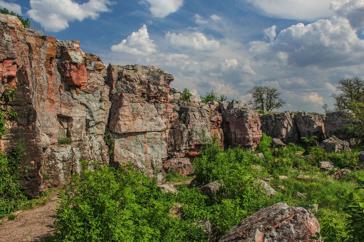 Rock formations against cloudy sky at pipestone national monument
