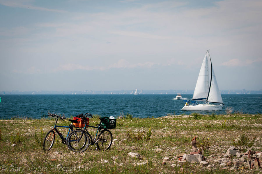 Beach Beauty In Nature Bicycle Blue Cliff Day Grass Horizon Over Water Land Vehicle Mode Of Transport Nature Non-urban Scene Outdoors Remote Scenics Sea Shore Sky Stationary Tourism Tranquil Scene Tranquility Transportation Vacations Water