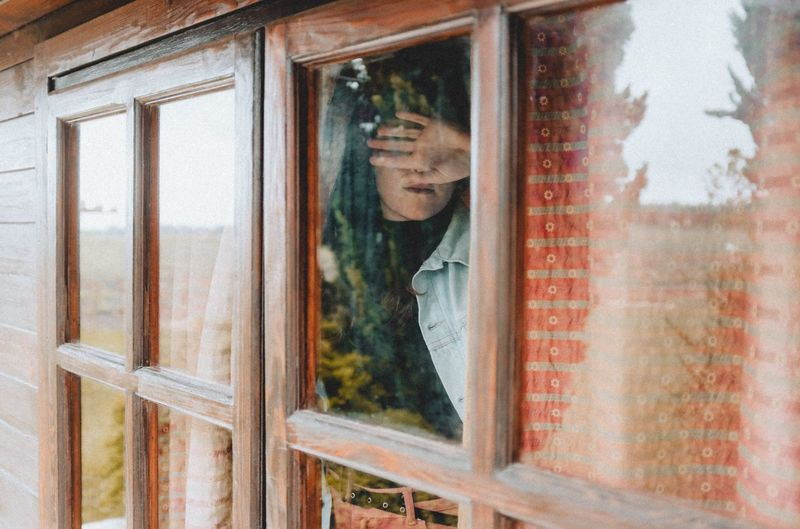 Window Glass - Material Reflection One Person Transparent Day Real People Front View Portrait Close-up Looking Young Adult