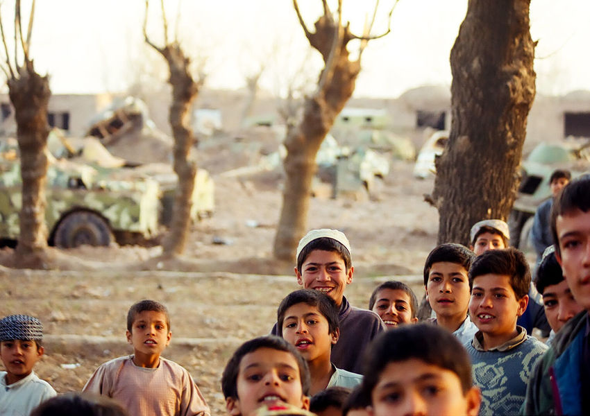 Abandoned 2001 Afghanistan Armored Vehicle Blown Up Boys Life Returns Peace Has Come Real People Smiling Tanks The War Is Over Trees