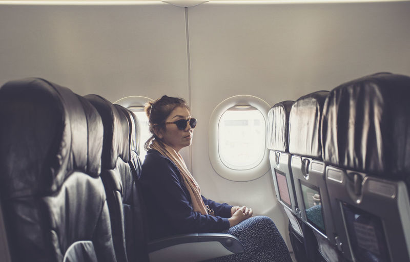 Woman sitting in airplane