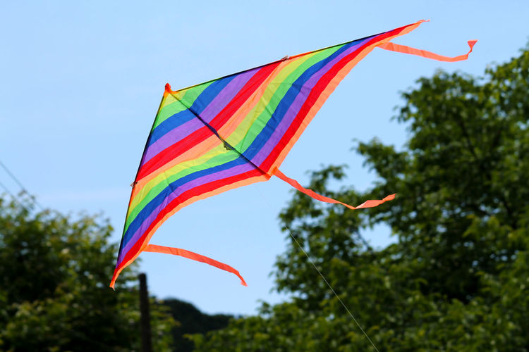 Low angle view of colorful kite against sky