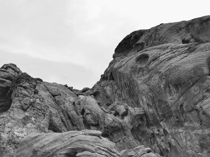 Black and white landscape of large rock formations Rock Formations Valley Of Fire State Park Black And White Mountain Low Angle View Nature Rock - Object Sky Day No People Beauty In Nature Scenics Cliff Tranquility Close-up Outdoors