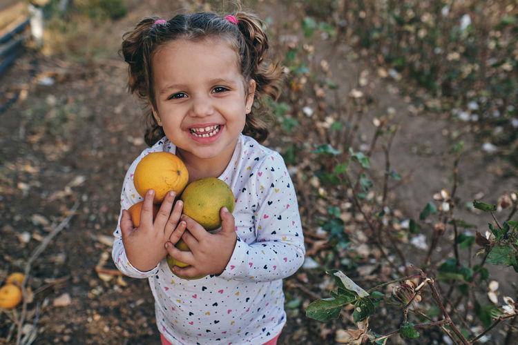 Portrait of happy girl holding ice cream