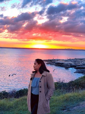 She loves moonlight and rainstorms and so many other things that have soul. #australia #visitnsw Water Sea Sunset Sky Beauty In Nature Beach Standing Scenics - Nature Horizon Over Water Real People Casual Clothing Tranquility