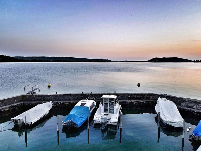 Sunset over Lake Biel Lake Water Nautical Vessel Sunset Blue Clear Sky Sky Moored Harbor Port Boat