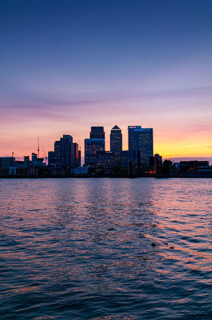 Canary Wharf Canary Wharf River Thames Architecture Beauty In Nature Building Exterior Built Structure Canonphotography City Cityscape Day Modern Nature No People Outdoors River Scenics Sky Skyscraper Sunset Travel Destinations Urban Skyline Water Waterfront