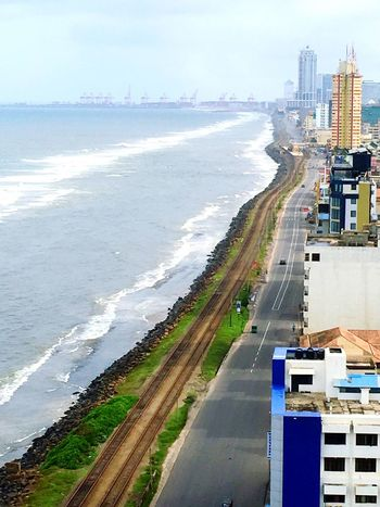Adapted To The City Water Sea Outdoors Beach Road Day No People Nature Cloud - Sky High Angle View Colombo