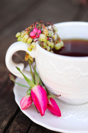 Close-up of tea cup and flowers