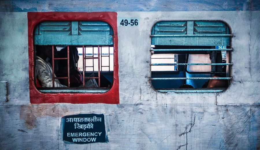 ° E M E R G E N C Y ° Window Red Day Outdoors Train Emergency Exit India Indiapictures Indiatravelgram K_3yur Everydayindia Streetphotography Travel Photography Traveller No People Close-up