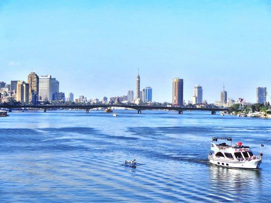 City Architecture Sea Water Travel Destinations Urban Skyline Built Structure Nautical Vessel Building Exterior Cityscape Outdoors Sky Sailing Beach Skyscraper People Day Mammal The Nile River The Nile Bridge The Nile