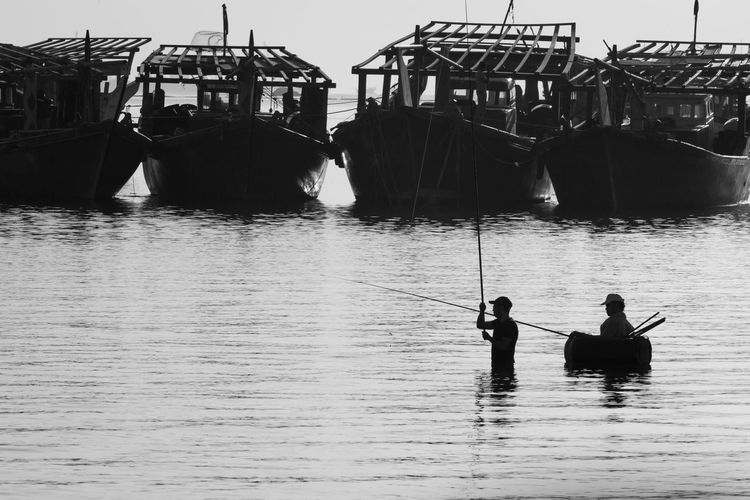 A boat barrier in the fisherman Silhouette Outdoors Water Real People Men Life In KSA Landscape EyeEm Maket EyeEm Fresh On Eyeem  Uniqueness
