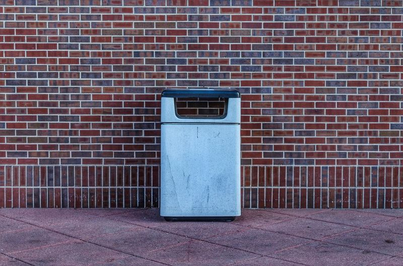 Street trash. Brick Wall Wall - Building Feature Built Structure Tile No People Architecture Building Exterior Outdoors Close-up Day Mood Nikon Lines