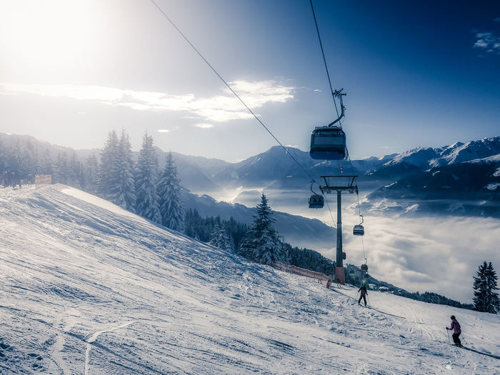 People Skiing On Snowcapped Mountains During Sunny Day