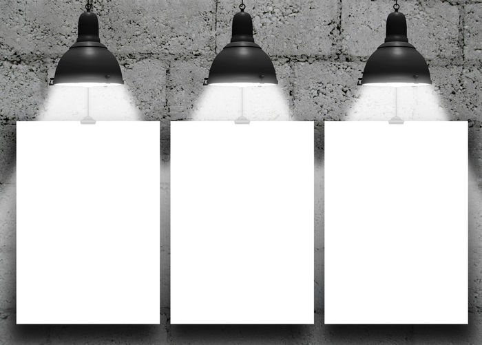 Close-up of three paper sheet frames with lamps on concrete blocks wall background 2015  Backgrounds Blackandwhite Clips Concrete Blocks Wall Display Empty Frames Home Interior Indoors  Lamps No People Paper Photo Product Placement Three Wall - Building Feature