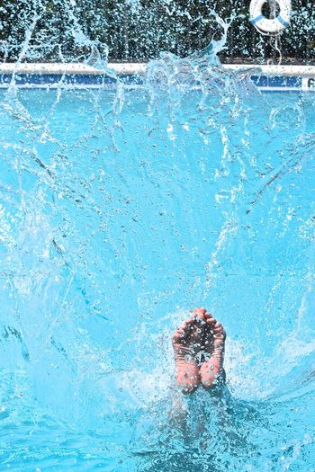 Low section of woman swimming in pool