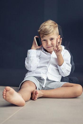 Portrait of cute boy sitting