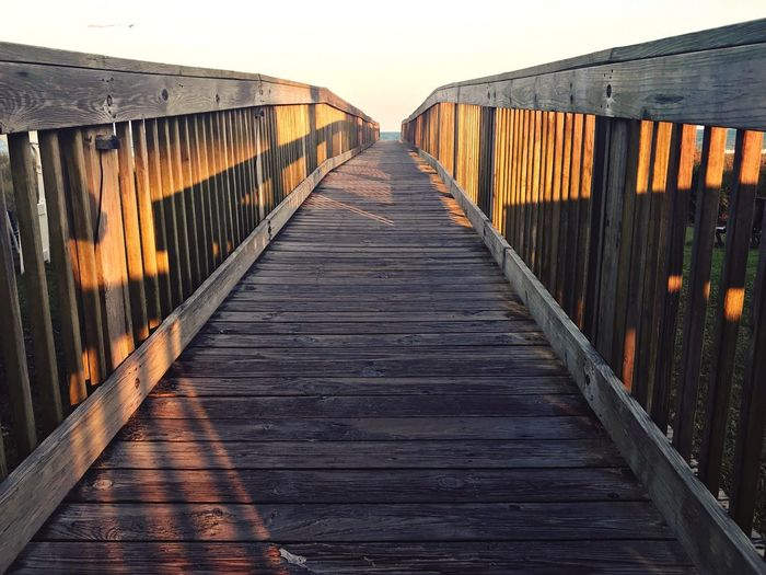 Wood Beach Life Beach Photography Beach The Way Forward Direction Diminishing Perspective Built Structure Architecture Sky Wood - Material Nature Bridge Sunset Railing vanishing point Clear Sky Water Bridge - Man Made Structure Outdoors No People