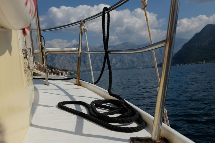 Rope on deck of boat Rope Boat Deck Boat Safety Cloud - Sky Deck Horizon Over Water Metal Nature Nautical Vessel No People Outdoors Railing Safety Scenics Sea Sky Water