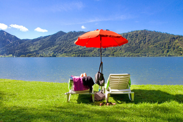 Relaxing on lake Schliersee, Bavaria, Germany Bavaria Green Happy Schliersee Sunlounger Tranquility Blue Destination Enjoyment Germany Health Hotel Lake Landscape Mountain Nature Recovery Relax Relaxation Sky Sun Sunshade Tranquility Vacation Water