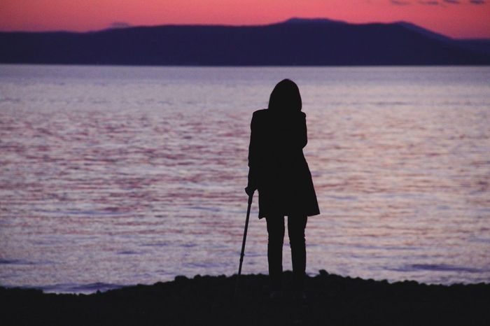 Injured Silhouette Crutches Sea Side Red Sky Blood Sky Sun Set