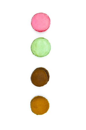 macarons isolated on white background, sweet colorful macarons in row Chocolate Dessert Green Macarons Macaroons Textured  Backgrounds Banner Brown Card Food French Header Homepage Macaroni Macaroon Pink Color Pistachio Space Sweet Sweet Food Sweets Tasty Textcard White Background